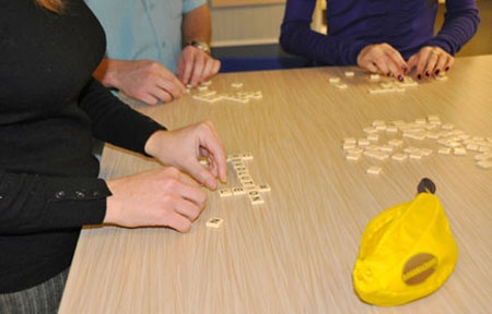 Baudville Employees Playing Bananagrams