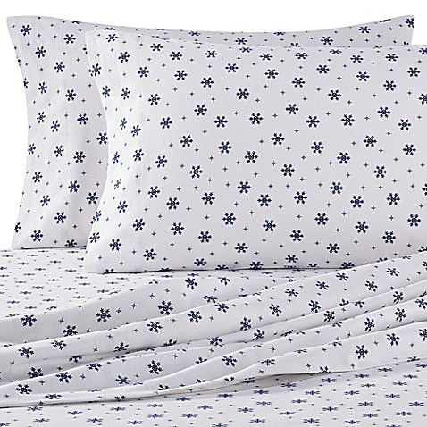The Seasons Collection® Heavyweight Flannel Snowflake Sheet Set in Navy/White at Bed Bath & Beyond in Cypress, TX | Tuggl