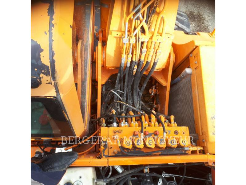 CASE PELLES SUR PNEUS WX165 equipment  photo 17
