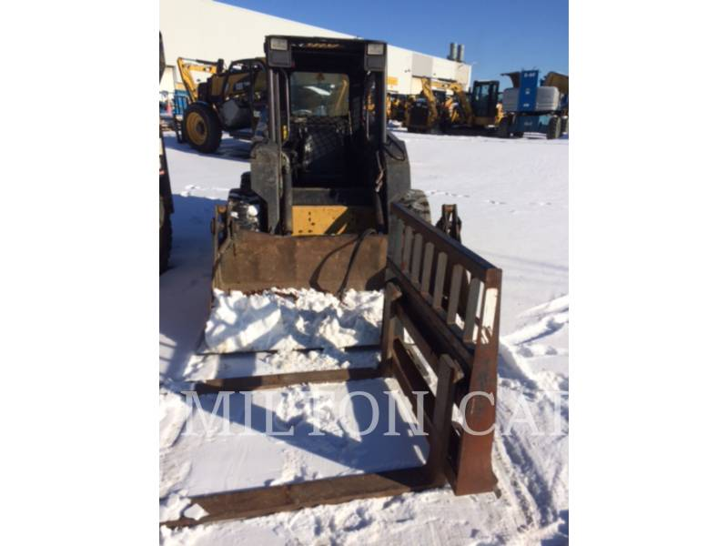 NEW HOLLAND LTD. CHARGEURS COMPACTS RIGIDES LX665 equipment  photo 2
