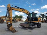 Equipment photo CATERPILLAR M313D PELLES SUR PNEUS 1