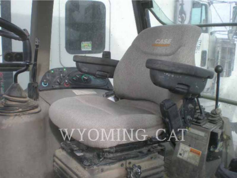CASE/NEW HOLLAND BAGGERLADER 580M II equipment  photo 10