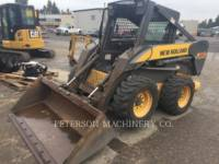 Equipment photo NEW HOLLAND LTD. L180 SKID STEER LOADERS 1