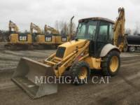 Equipment photo NEW HOLLAND 555E BAGGERLADER 1