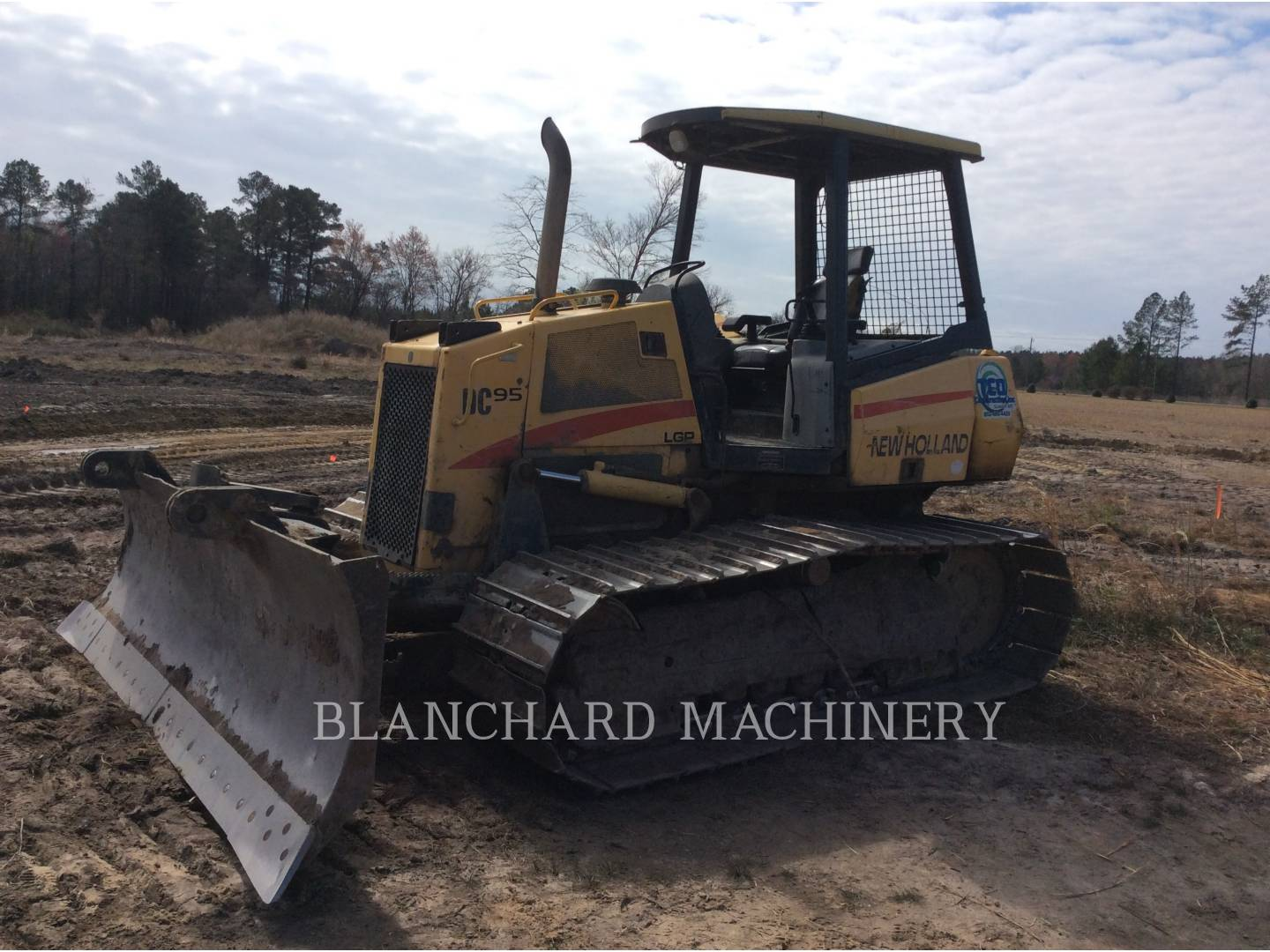 Detail photo of 2004 New Holland DC95 LGP from Construction Equipment Guide