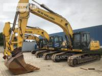 Equipment photo FORD/NEW HOLLAND E305C RUPSGRAAFMACHINES 1