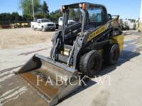 Equipment photo NEW HOLLAND LTD. L218 SKID STEER LOADERS 1