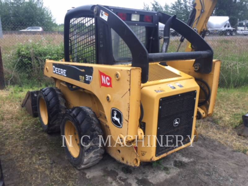 JOHN DEERE TRATTORI CINGOLATI 317 equipment  photo 1
