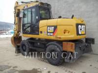 CATERPILLAR ESCAVATORI GOMMATI M313D equipment  photo 1