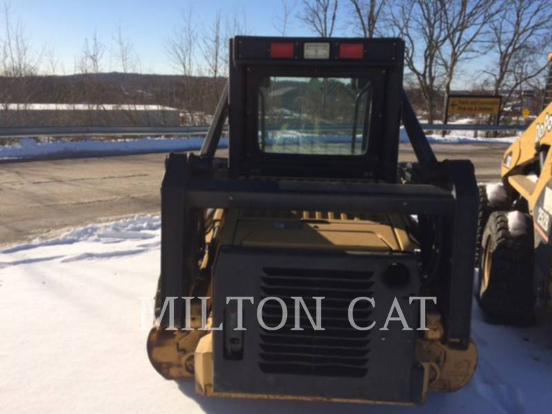 NEW HOLLAND LTD. CHARGEURS COMPACTS RIGIDES LX665 equipment  photo 6