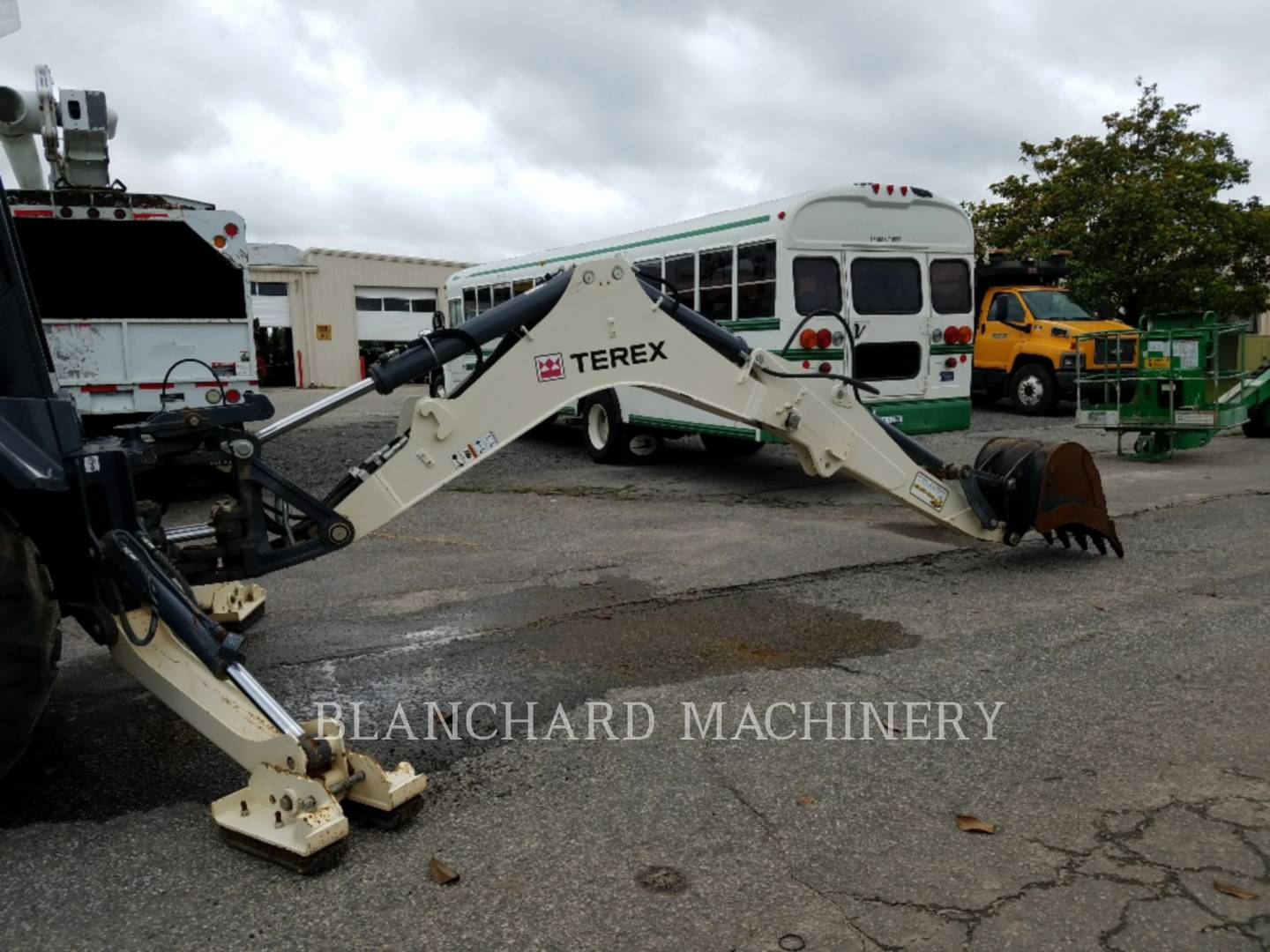 Detail photo of 2015 Terex TLB840 from Construction Equipment Guide