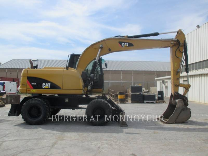 Caterpillar EXCAVATOARE PE ROŢI M313D equipment  photo 1