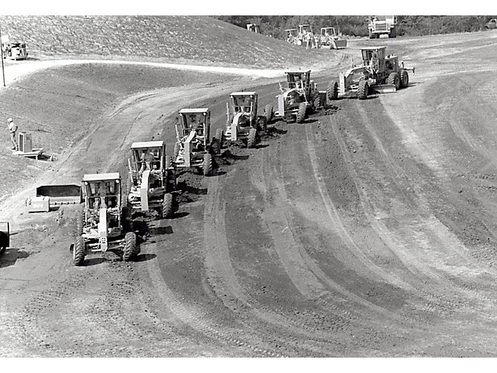 A series of Motor Graders in perfect formation