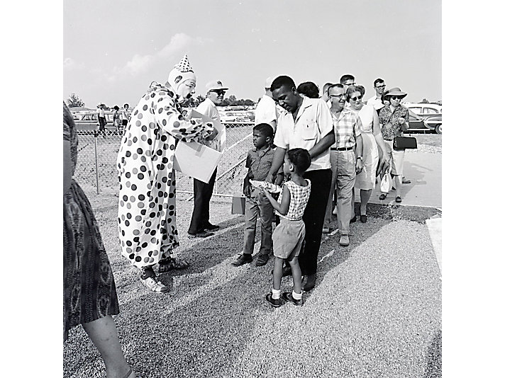 Clowns greet attendees in 1964