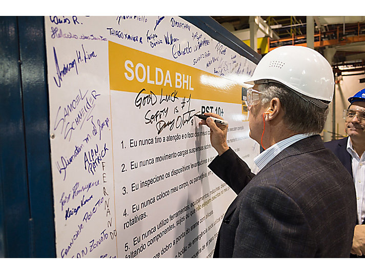 Oberhelman signs safety board.