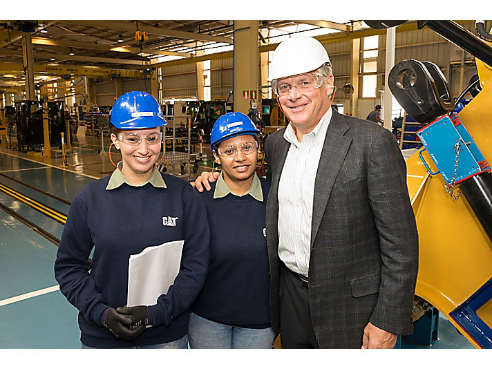 Oberhelman with employees in Campo Largo.
