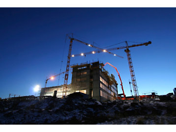 Construction sites with cranes photograph