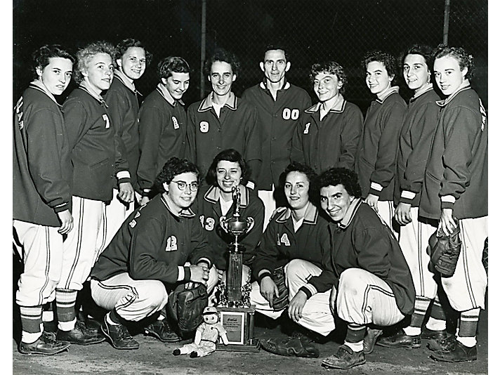 1952 Dieselettes team with their game trophy. The 1952 team is said to be one of McCord's strongest team in his 25 year career.
