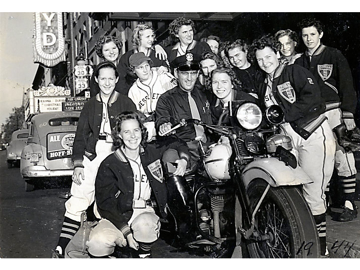 1944 Dieselettes Team poses with a police officer in Ft. Wayne.