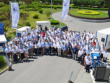 FG Wilson dealership personnel outside the Tianjin facility photograph