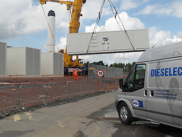 FG Wilson containerized generator set being craned onto site photograph