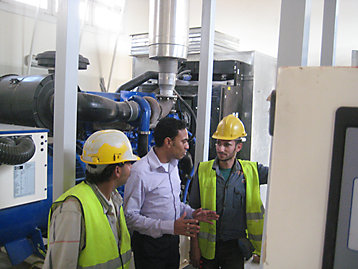 Work men on site reviewing installation of FG Wilson generator sets