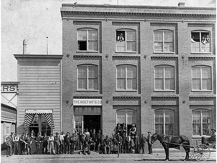 Employees outside of Benjamin Holt's workshop in Stockton, California.