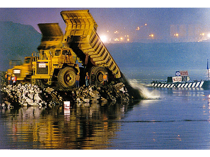 Caterpillar 777C off-highway trucks during construction of Three Gorges Dam.