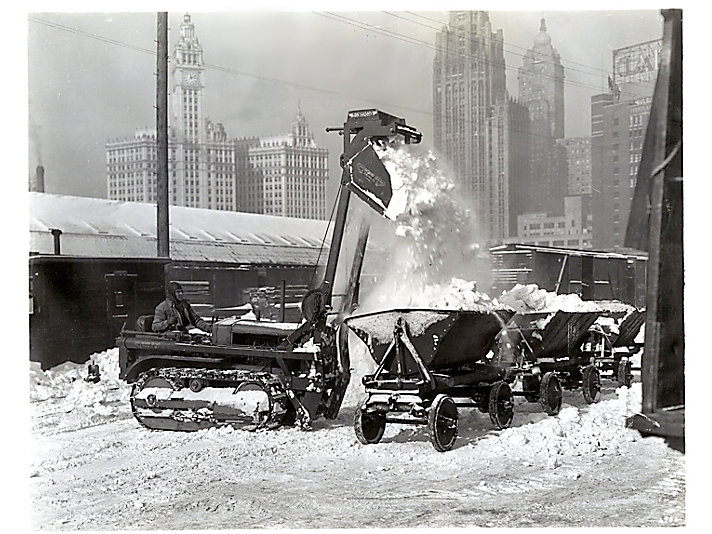 A Caterpillar Twenty plowing the roads during a harsh Chicago winter in 1933