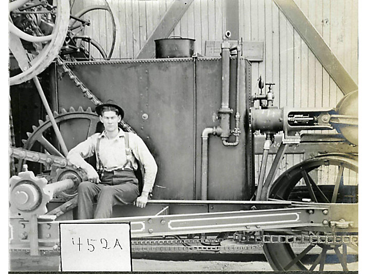 c. 1904 - A Holt employee - possibly Jess - sits on the No. 77 that Jess designed the engine for. The No. 77 later became the first track-type tractor