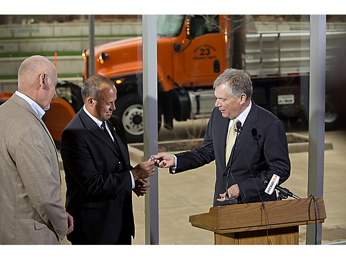 Doug presents the truck key to Peoria Mayor Jim Ardis