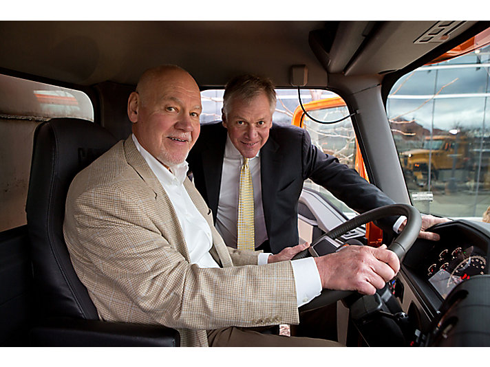 Doug and East Peoria Mayor Dave Mingus rev up the truck for the first time