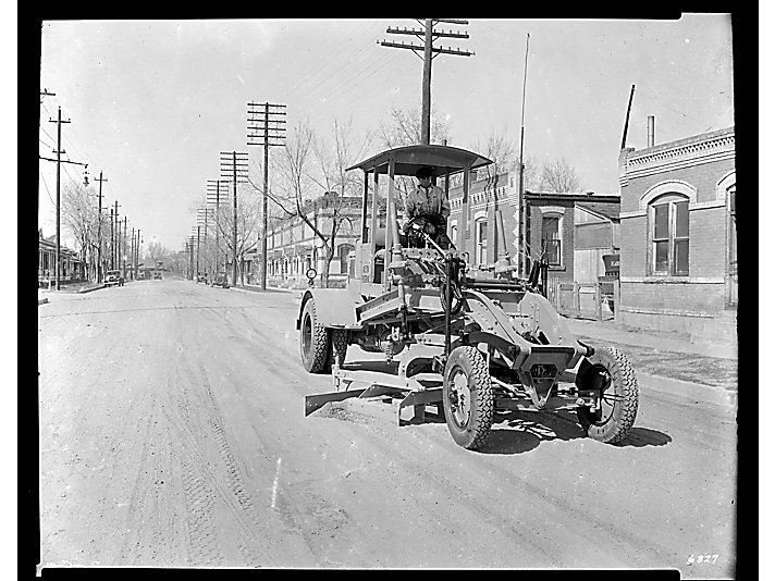 Auto patrol paving roads in 1931.