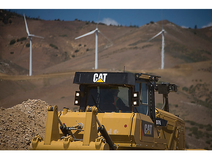 A Cat D7E Track-Type Tractor works on a wind farm development.