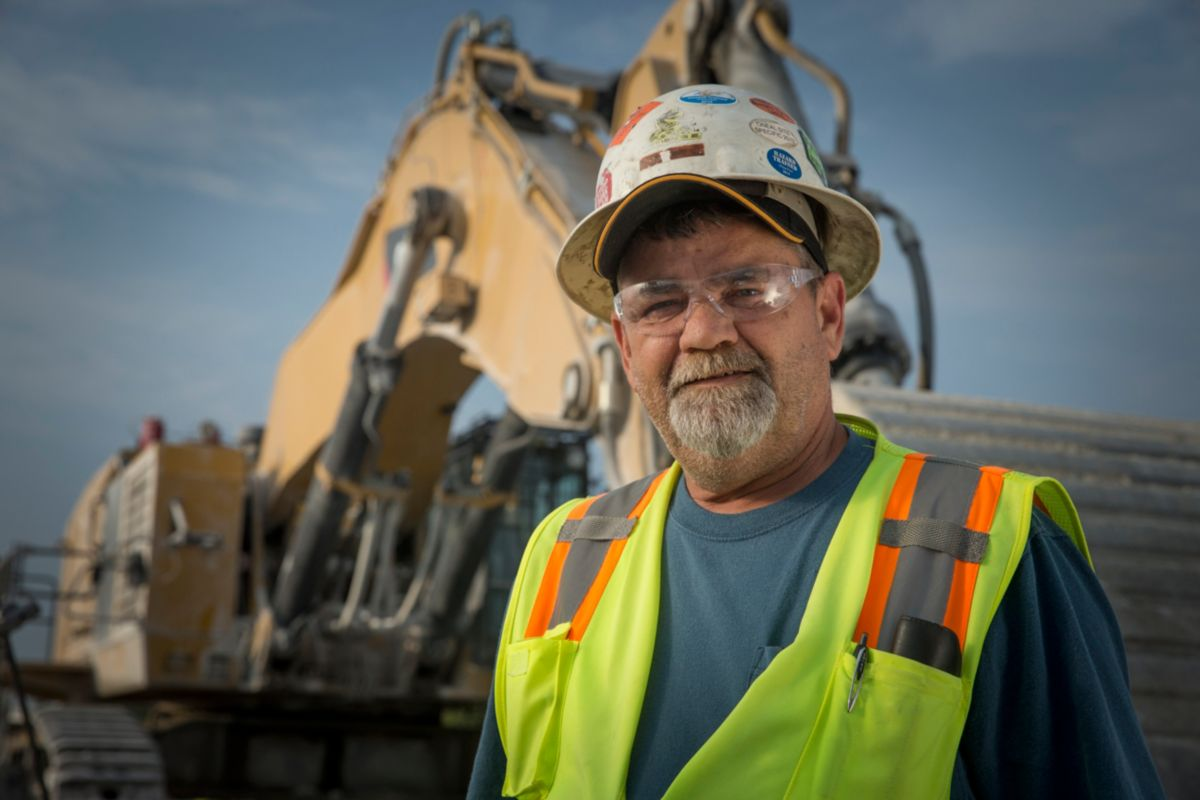 """They had to put a fifth truck on us to keep up with the machine,"" says shovel operator Dale Riffe. ""I don't see a problem keeping up with five trucks. I mean, that's just total production digging right there."""