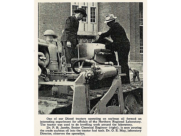 1941 - Crude soybean oil is poured into the fuel tank outside the Peoria Ag Lab.