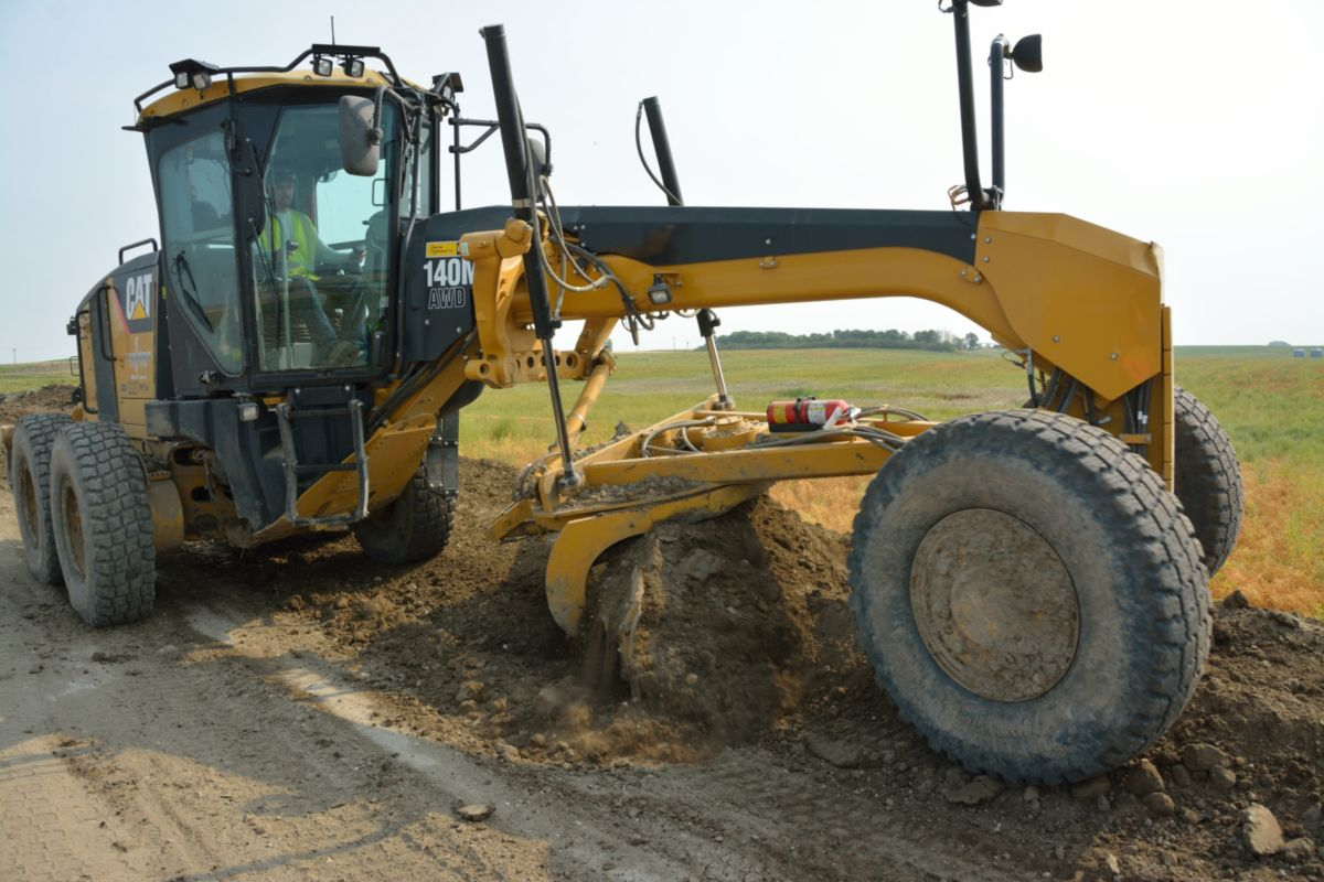 A Cat<sup>®</sup> 140M Motor Grader is at work at one of Loenbro's job sites.