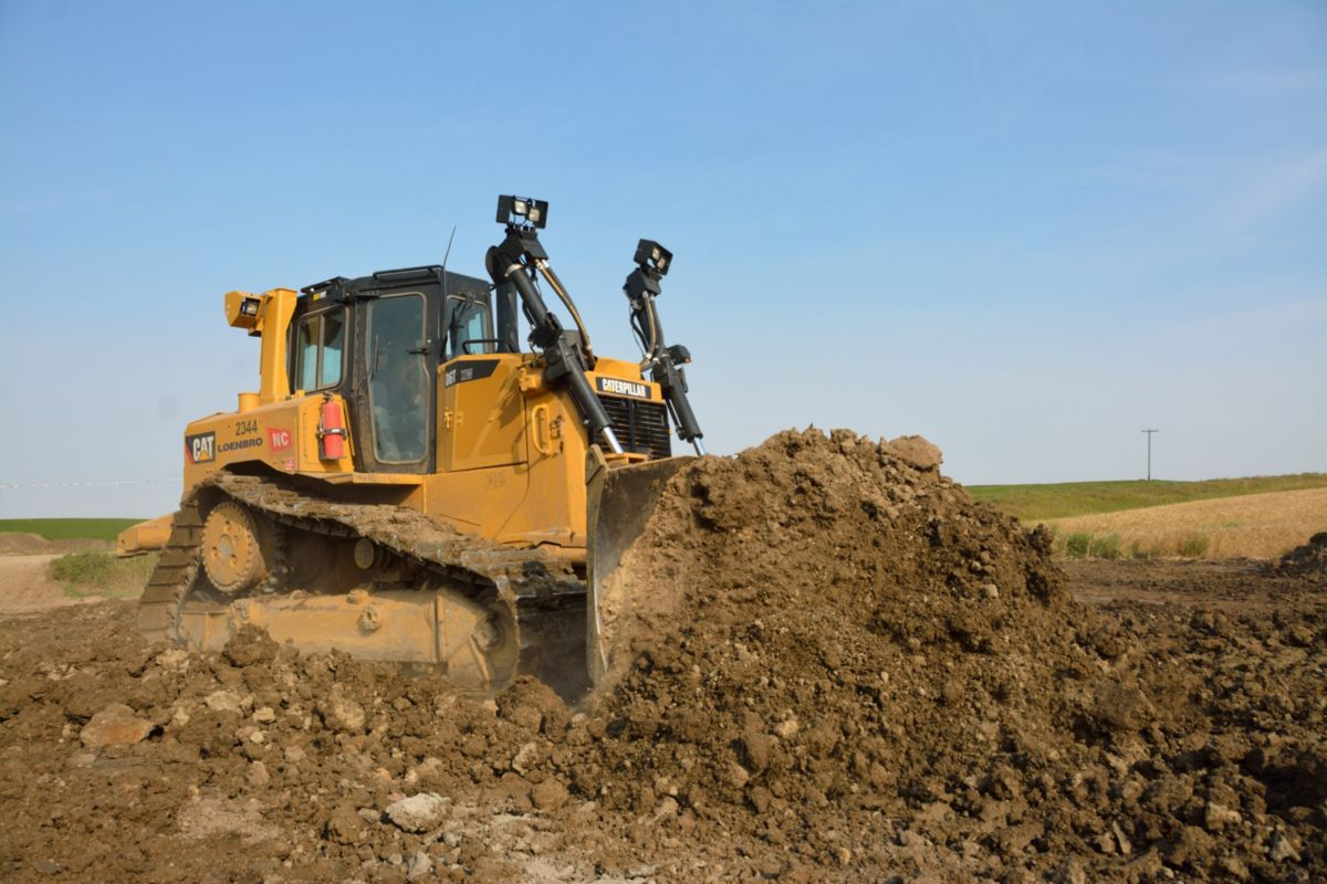 A Cat<sup>®</sup> D6T Dozer pushes dirt at one of Loenbro's job sites.