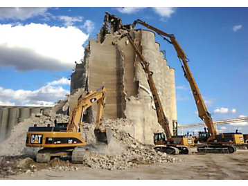 Cat® Material Handlers Tearing Down Silos on a Demolition Site