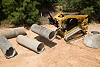 Cat® 289D Compact Track Loader and Material Handling Arm Moving Pipe