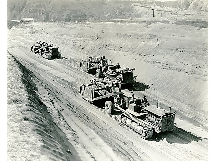 Caterpillar Diesel Seventy-Fives pulling scrapers on the north of Grand Coulee Dam in 1975.