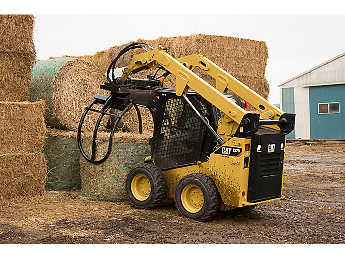 Cat® Bale Grab Picking Up a Wrapped Bale