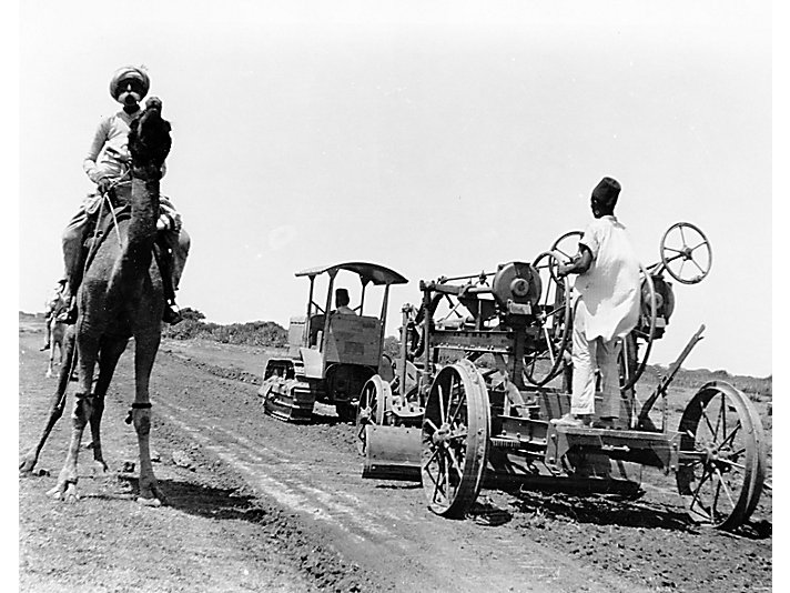 Caterpillar Twenty tractor doing road work in India, 1927