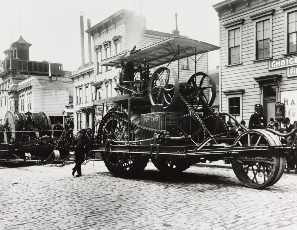 Early image of Holt steam tractor No.37 working laying street car cable before the quake in ca. 1905.