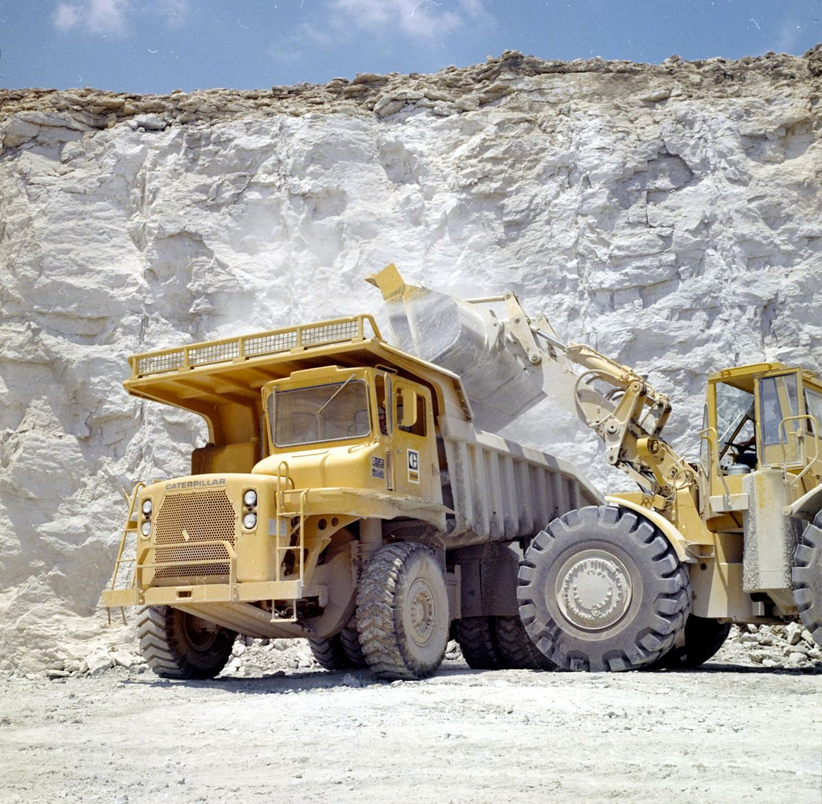 Cat 769B Off-Highway Truck and Cat Wheel Loader, 1969.