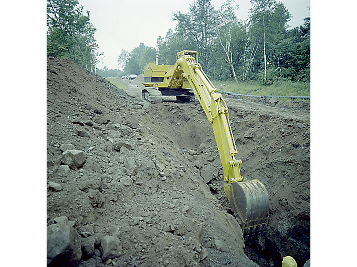 Caterpillar's first hydraulic excavator model, the 225, hard at work in the 1970s.