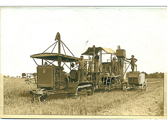 Holt 60 tractor pulling a Holt Combine Harvester in North Africa.
