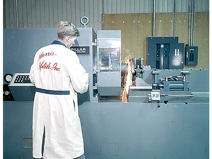 Customer at work using a Cat Inertia Welder in 1968.