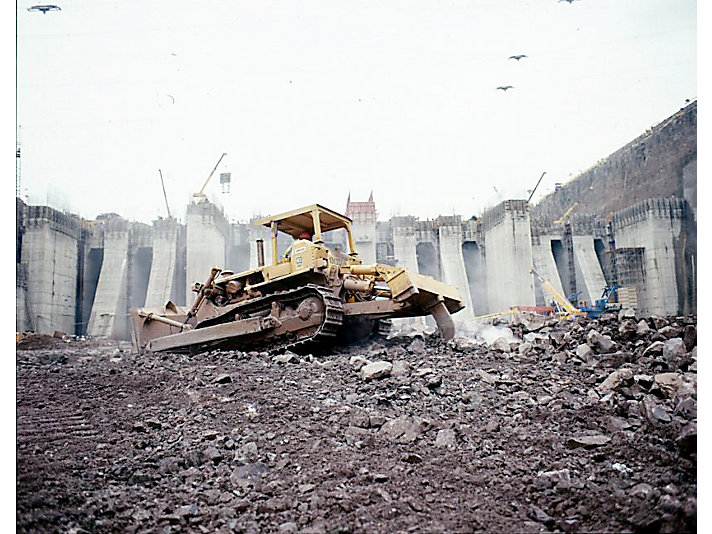 Cat dozer working on dam construction in Brazil, 1978