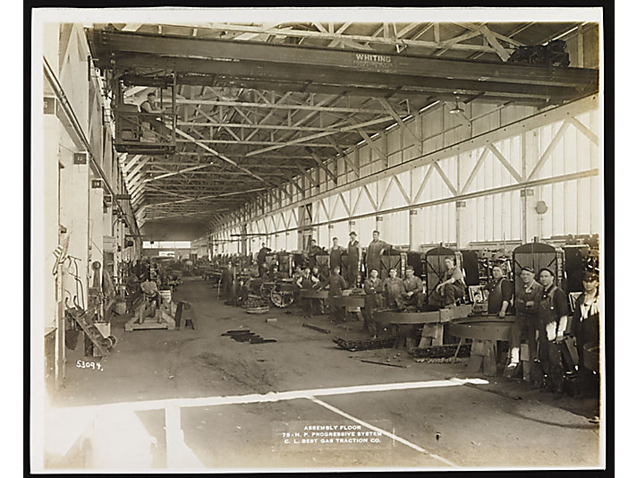 C.L. Best employees assembling Best 75 tractors in 1918.